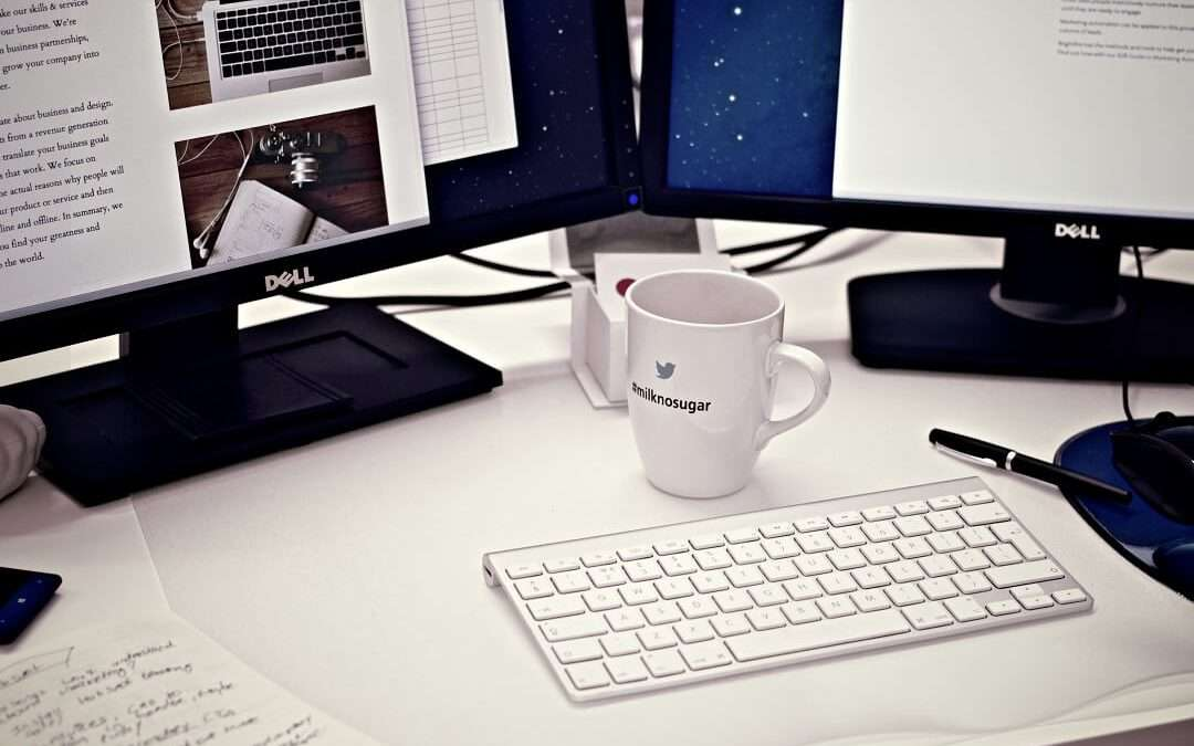 Mug and computer on desk