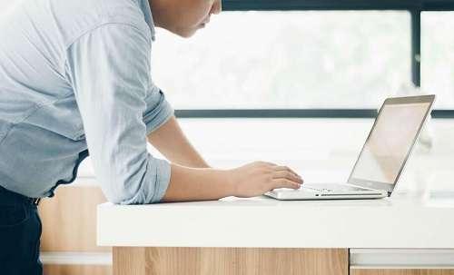 Man working at laptop on desk